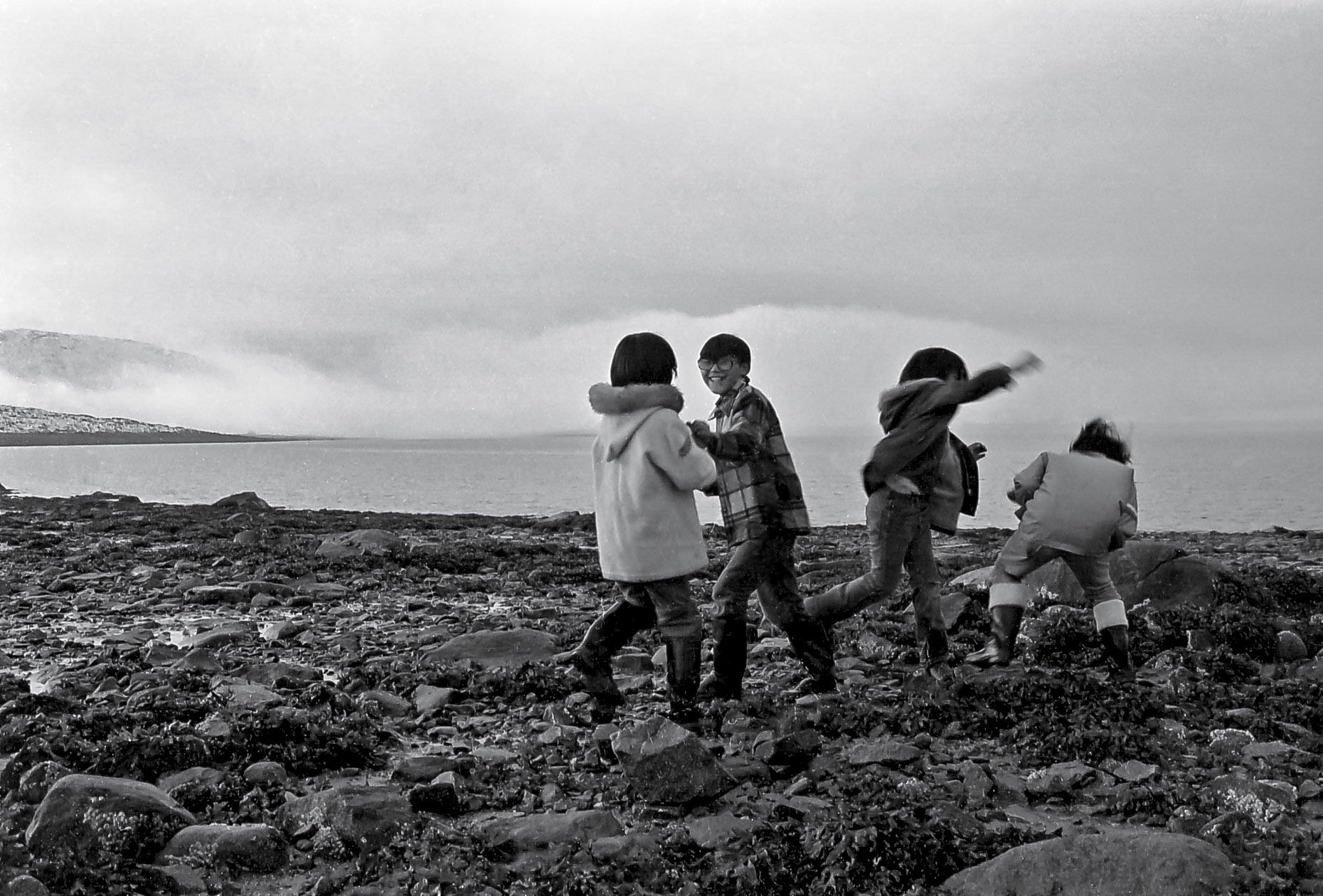 23-Inuit-boys-fooling-around-After-the-tide,-Cape-Dorset,-Canadian-Arctic-